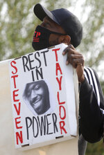 Michael Taylor holds a sign in memory of his brother Steven Taylor, who was shot and killed by San Leandro Police Officer Jason Fletcher, outside the East County Hall of Justice on Tuesday, Sept. 15, 2020, in Dublin, Calif. A police officer facing manslaughter charges in the shooting death of a Black man inside a San Francisco Bay Area Walmart store was handcuffed and taken to jail following a court appearance Tuesday. Judge Barbara Dickinson denied a defense attorney request to allow San Leandro Police Officer Jason Fletcher to immediately post $200,000 bail, saying it was not the court's practice to allow that. (Aric Crabb/Bay Area News Group via AP)