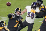 Pittsburgh Steelers quarterback Ben Roethlisberger (7) throws a touchdown pass to wide receiver JuJu Smith-Schuster as Baltimore Ravens outside linebacker L.J. Fort (58) pressures him during the second half of an NFL football game Wednesday, Dec. 2, 2020, in Pittsburgh. (AP Photo/Gene J. Puskar)