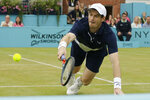 Britain's Andy Murray plays a return during his men's doubles final tennis match with Spain's Feliciano Lopez against Britain's Joe Salisbury and the United State's Rajeev Ram at the Queens Club tennis tournament in London, Sunday June 23, 2019. (AP Photo/Tim Ireland)