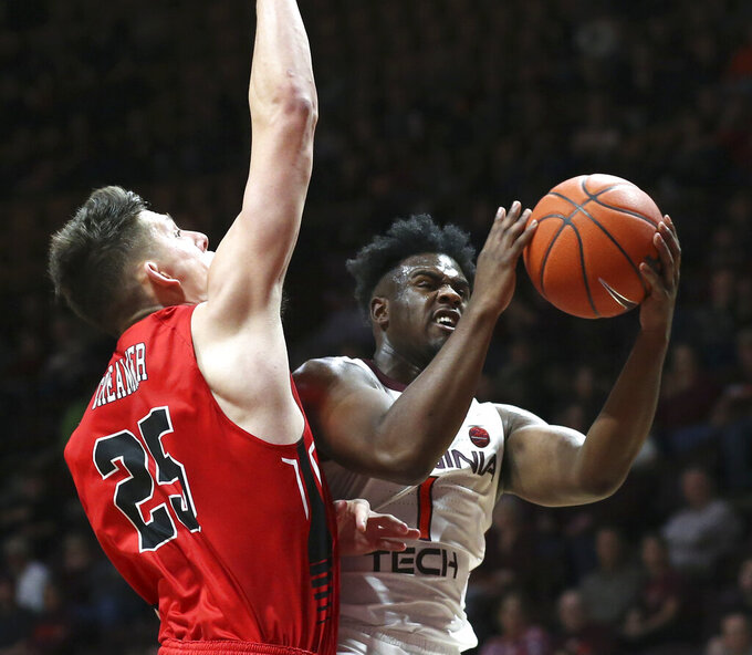 Virginia Tech's Isaiah Wilkins (1) drives to the basket and scores past Virginia Military Institute's defender Tyler Creammer (25) in the second half of an NCAA college basketball game Saturday, Dec. 21 2019, in Blacksburg, Va. (Matt Gentry/The Roanoke Times via AP)