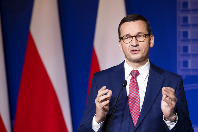 FILE - In this Sept. 17, 2020 file photo, Poland's Prime Minister Mateusz Morawiecki speaks during a news conference at the Palace of the Grand Dukes of Lithuania in Vilnius, Lithuania. Morawiecki says on Friday, Nov. 27 he has confirmed to German Chancellor Angela Merkel that Warsaw is ready to block the EU's huge budget and recovery package because it's linked to democratic standards in member states. Mateusz Morawiecki wrote on Facebook that he spoke with Merkel, whose country holds the rotating European Union presidency, about the 1.8 trillion-euro ($2.1 trillion) budget for 2021-2027 and the urgently needed coronavirus recovery package that is to be implemented in January.(AP Photo/Mindaugas Kulbis, file)
