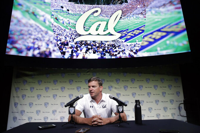 FILE - In this July 24, 2019, file photo, California head coach Justin Wilcox answers questions during the Pac-12 Conference NCAA college football Media Day in Los Angeles. In two seasons as head coach at California, Justin Wilcox has helped turn one of the nation's worst defenses into one of the better ones.  (AP Photo/Marcio Jose Sanchez, File)