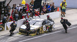 The crew of Tyler Reddick (8) services the car during a pit stop at a NASCAR Cup Series auto race at Indianapolis Motor Speedway, Sunday, Aug. 15, 2021, in Indianapolis. (AP Photo/Doug McSchooler)