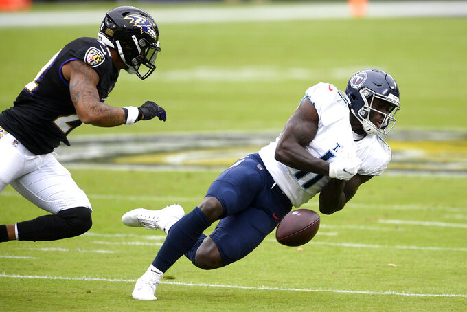 Tennessee Titans wide receiver A.J. Brown (11) is unable to catch a pass against the Baltimore Ravens during the first half of an NFL football game, Sunday, Nov. 22, 2020, in Baltimore. (AP Photo/Nick Wass)