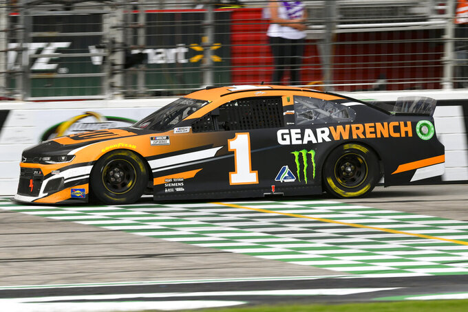 Kurt Busch completes one of the final laps before winning NASCAR Cup Series auto race, Sunday, July, 11, 2021, in Hampton, Ga. (AP Photo/John Amis)
