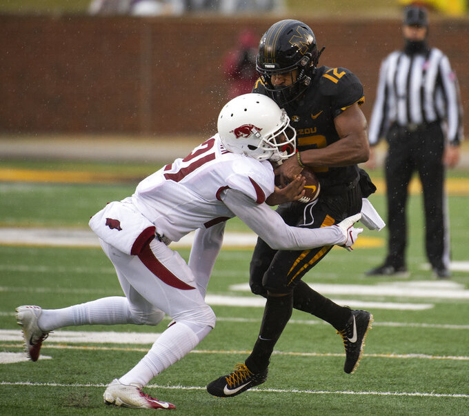 Missouri wide receiver Johnathon Johnson, right, is hit by Arkansas defensive back Montaric Brown, left, as he catches the ball during the first half of an NCAA college football game Friday, Nov. 23, 2018, in Columbia, Mo. (AP Photo/L.G. Patterson)