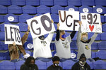 Central Florida fans hold up signs at the Boca Raton Bowl NCAA college football game between UCF and BYU on Tuesday, Dec. 22, 2020, in Boca Raton, Fla. (Mike Stocker/South Florida Sun-Sentinel via AP)