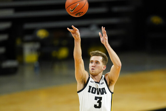 Iowa guard Jordan Bohannon shoots a 3-point basket during the second half of an NCAA college basketball game against Northwestern, Tuesday, Dec. 29, 2020, in Iowa City, Iowa. Iowa won 87-72. (AP Photo/Charlie Neibergall)