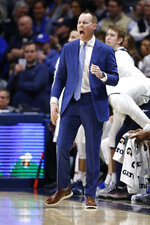Xavier coach Travis Steele shouts instructions to the team during the first half of an NCAA college basketball game against Bulter, Saturday, March 7, 2020, in Cincinnati. (AP Photo/Gary Landers)