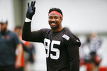 FILE - In this June 6, 2019, file photo, Cleveland Browns defensive end Myles Garrett reacts after a play during practice at the team's NFL football training facility in Berea, Ohio. The expansion era has been tortuous, two embarrassing decades of despair and dysfunction.  Well, those painful days appear to be ending, with an array of potent offensive weapons surrounding fiery second-year quarterback Baker Mayfield, and an imposing defensive front led by super freak end Myles Garrett. (AP Photo/Ron Schwane, File)