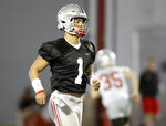 Ohio State quarterback Justin Fields runs through a drill during an NCAA college football practice in Columbus, Ohio, Wednesday, March 6, 2019. (AP Photo/Paul Vernon)