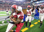 Oklahoma cornerback Tre Norwood (13) is congratulated by Justin Broiles (25) after making a game-sealing interception at the end of the Big 12 Conference championship NCAA college football game on Saturday, Dec. 1, 2018, in Arlington, Texas. Oklahoma won 39-27. (AP Photo/Jeffrey McWhorter)