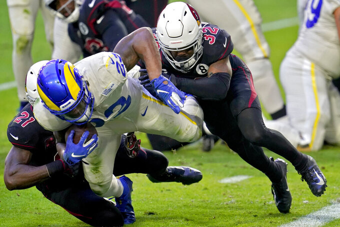 Los Angeles Rams running back Cam Akers (23) is stopped short of the goal line by Arizona Cardinals strong safety Budda Baker (32) and cornerback Patrick Peterson (21) during the first half of an NFL football game, Sunday, Dec. 6, 2020, in Glendale, Ariz. (AP Photo/Ross D. Franklin)