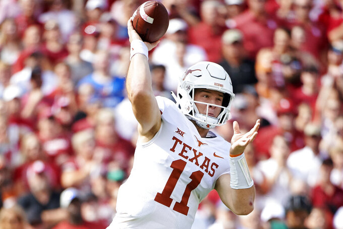 FILE - In this Oct. 6, 2018, file photo, Texas quarterback Sam Ehlinger (11) throws a pass against Oklahoma during the first half of an NCAA college football game at the Cotton Bowl in Dallas. The Longhorns face Oklahoma in the Big 12 championship game on Saturday. (AP Photo/Cooper Neill, File)