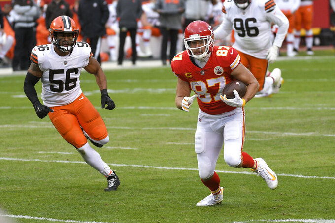 Kansas City Chiefs tight end Travis Kelce (87) runs from Cleveland Browns linebacker Malcolm Smith, left, after catching a pass during the first half of an NFL divisional round football game, Sunday, Jan. 17, 2021, in Kansas City. (AP Photo/Reed Hoffmann)