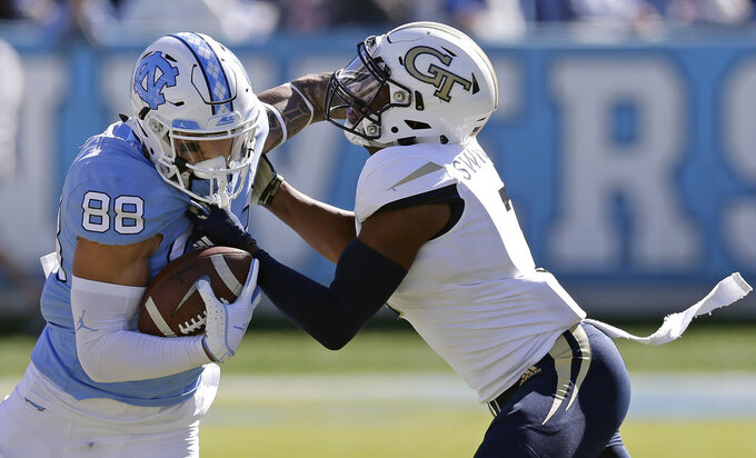 North Carolina's Beau Corrales (88) runs the ball while Georgia Tech's Tre Swilling tackles during the first half of an NCAA college football game in Chapel Hill, N.C., Saturday, Nov. 3, 2018. (AP Photo/Gerry Broome)