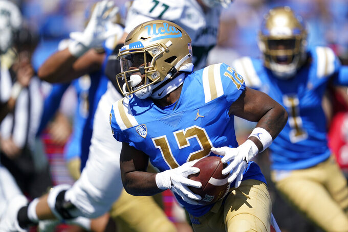 UCLA defensive back Martell Irby (12) runs to the end zone for a touchdown during the second half of an NCAA college football game against Hawaii Saturday, Aug. 28, 2021, in Pasadena, Calif. (AP Photo/Ashley Landis)
