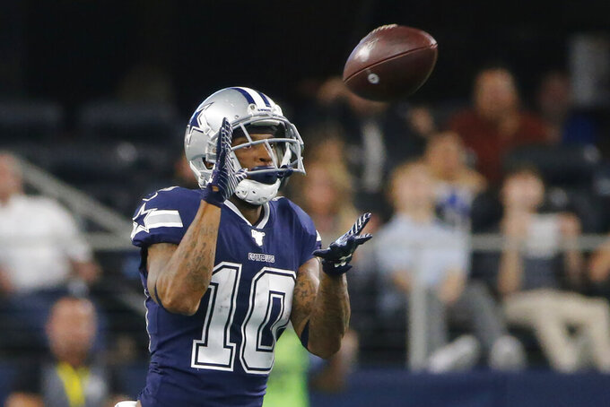 Dallas Cowboys wide receiver Tavon Austin (10) makes a catch on a pass from Dak Prescott and takes it in for a touchdown in the first half an NFL football game against the Los Angeles Rams in Arlington, Texas, Sunday, Dec. 15, 2019. (AP Photo/Michael Ainsworth)