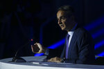 Greece's Prime Minister Kyriakos Mitsotakis addresses reporters during a news conference at the Thessaloniki International Fair, in the northern city of Thessaloniki, Greece, Sunday, Sept. 12, 2021. (AP Photo/Giannis Papanikos)