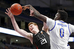 Pittsburgh's Eric Hamilton (0) blocks a shot by Miami's Sam Waardenburg (21) during the first half of an NCAA college basketball game, Sunday, Feb. 2, 2020, in Pittsburgh. (AP Photo/Keith Srakocic)
