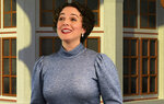 """This image released by The Irish Repertory Theatre shows Melissa Errico during a performance of """"Meet Me in St. Louis."""" Charlotte Moore, the artistic director and co-founder of the acclaimed Irish Repertory Theatre in New York City, has put on a free streaming of the holiday production with a dozen cast members, each filmed remotely and then digitally stitched together. (Muireann Lalor/The Irish Repertory Theatre via AP)"""
