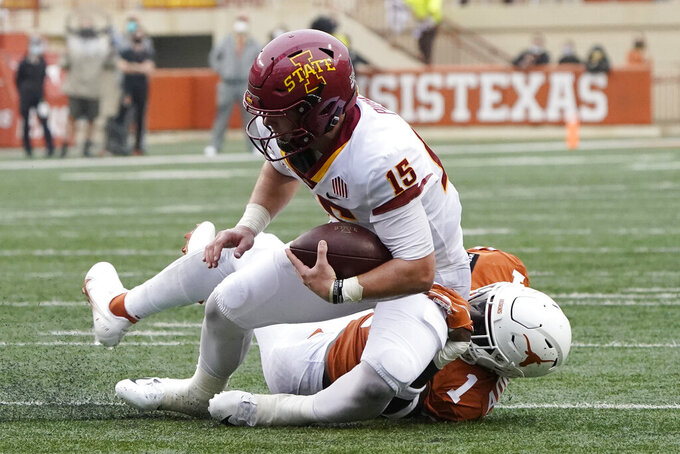 Iowa State quarterback Brock Purdy (15) is taken down on a run by Texas defensive back Chris Adimora (1) during the first half of an NCAA college football game, Friday, Nov. 27, 2020, in Austin, Texas. (AP Photo/Eric Gay)