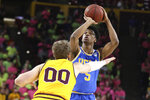 UCLA's Chris Smith (5) eyes the basket as Arizona State's Mickey Mitchell (00) defends during the first half of an NCAA college basketball game Thursday, Feb. 6, 2020, in Tempe, Ariz. (AP Photo/Darryl Webb)