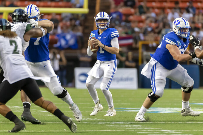 BYU quarterback Zach Wilson (1) drops back to pass during the second half of the team's Hawaii Bowl NCAA college football game against Hawaii, Tuesday, Dec. 24, 2019, in Honolulu. (AP Photo/Eugene Tanner)