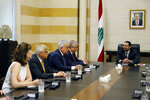 Lebanese Prime Minister Saad Hariri, right, meets with Russia's special presidential envoy to Syria Alexander Lavrentiev, second right, and delegations, in Beirut, Lebanon, Wednesday, June 19, 2019. Lavrentiev invited Lebanon to attend as an observer the next Moscow-backed meeting seeking a political solution in Syria to be held in Kazakh capital in July. (AP Photo/Bilal Hussein)