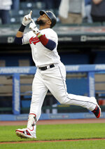 Cleveland Indians' Carlos Santana looks up after hitting a solo home run off Cincinnati Reds starting pitcher Luis Castillo in the fourth inning in a baseball game, Tuesday, June 11, 2019, in Cleveland. (AP Photo/Tony Dejak)