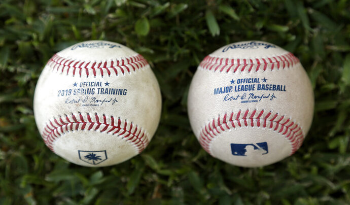 Major League Baseball's new prototype baseball, right, is shown next to a 2019 Spring Training game ball Wednesday, March 20, 2019, in Clearwater, Fla. (AP Photo/Chris O'Meara)