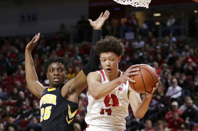Nebraska's Isaiah Roby (14) wins a rebound against Iowa's Tyler Cook (25) during the first half of an NCAA college basketball game in Lincoln, Neb., Sunday, March 10, 2019. (AP Photo/Nati Harnik)
