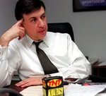 """FILE - Marv Albert talks about his return to national television as a part of Turner Sports to call NBA games on the TNT cable network during an interview at New York's Madison Square Garden, in this Monday, Feb. 15, 1999, file photo. Marv Albert plans to retire following the NBA's Eastern Conference finals, ending a broadcasting career that has spanned nearly 60 years. """"There is no voice more closely associated with NBA basketball than Marv Albert's,"""" NBA Commissioner Adam Silver said in a statement released Monday, May 17, 2021, by Turner Sports. (AP Photo/Lynsey Addario, File)"""