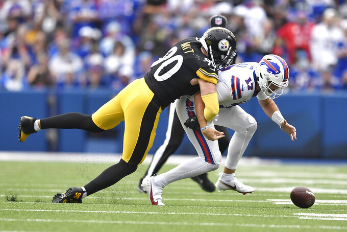 Buffalo Bills quarterback Josh Allen (17) fumbles as he is tackled by Pittsburgh Steelers outside linebacker T.J. Watt during the first half of an NFL football game in Orchard Park, N.Y., Sunday, Sept. 12, 2021. The Steelers recovered the ball. (AP Photo/Adrian Kraus)