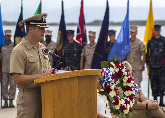 FILE - In this June 3, 2014, image provided by the U.S. Navy, Navy Capt. John R. Nettleton, then-commanding officer of Naval Station Guantanamo Bay, Cuba, speaks during a Battle of Midway commemoration ceremony.  Nettleton was convicted Friday, Jan. 17, 2020 of interfering with an investigation into the death of a civilian with whom the commander had fought and argued over his alleged affair with the man's wife. A federal jury in Jacksonville convicted Nettleton on charges of obstruction of justice, concealing material facts, falsifying records and making false statements.(Mass Communication Specialist 3rd Class Jacob Goff/U.S. Navy via AP)