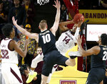 Arizona State forward Kimani Lawrence (14) tries to pass the ball under the basket around the defense of Colorado's Alexander Strating (10) during the first half of an NCAA college basketball game, Saturday, Jan. 5, 2019, in Tempe, Ariz. (AP Photo/Ralph Freso)
