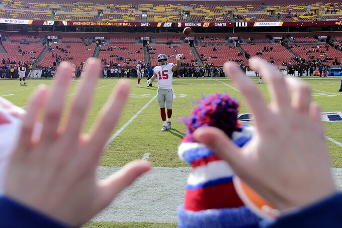 New York Giants wide receiver Golden Tate plays catch with fans prior to an NFL football game against the Washington Redskins, Sunday, Dec. 22, 2019, in Landover, Md. (AP Photo/Mark Tenally)