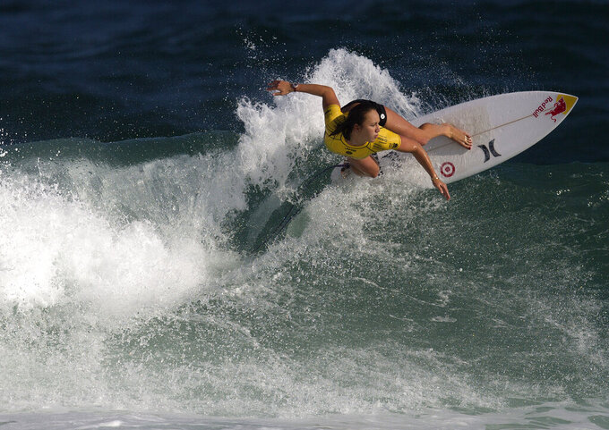 FILE - In this  Tuesday, May 12, 2015 file photo, Carissa Moore competes in the first round of the 2015 Oi Rio Pro World Surf League competition at Barra da Tijuca beach in Rio de Janeiro, Brazil. The geopolitics of the Olympics will be on display when Carissa Moore and John John Florence are in the surf zone. They're two of professional surfing's biggest stars and both compete in the World Surf League under the Hawaii flag. (AP Photo/Leo Correa, File)