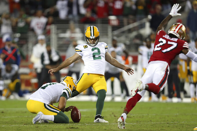 Green Bay Packers kicker Mason Crosby (2) kicks the game winning field goal from the hold of Corey Bojorquez during the second half of an NFL football game against the San Francisco 49ers in Santa Clara, Calif., Sunday, Sept. 26, 2021. (AP Photo/Jed Jacobsohn)