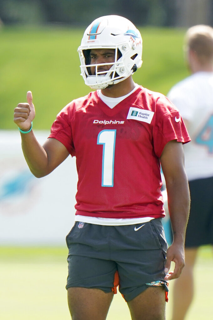 Miami Dolphins quarterback Tua Tagovailoa gives a thumbs up before running a drill during NFL football practice, Wednesday, July 28, 2021, in Miami Gardens, Fla. (AP Photo/Wilfredo Lee)
