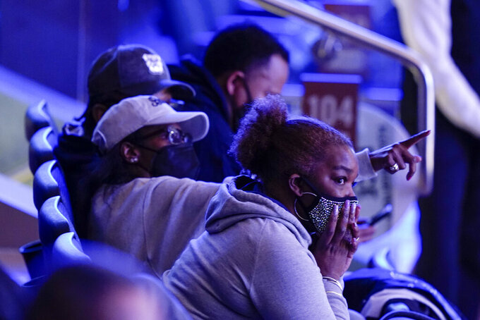 Fans watch during the second half of an NCAA college basketball game between Xavier and Butler in the Big East conference tournament Wednesday, March 10, 2021, in New York. (AP Photo/Frank Franklin II)