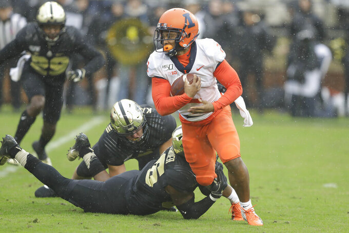 Illinois running back Reggie Corbin (2) is tackled by Purdue linebacker Jaylan Alexander (36) during the first half of an NCAA college football game, Saturday, Oct. 26, 2019, in West Lafayette, Ind. (AP Photo/Darron Cummings)