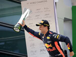 Red Bull driver Daniel Ricciardo of Australia celebrates with his trophy after winning the Chinese Formula One Grand Prix at the Shanghai International Circuit in Shanghai, Sunday, April 15, 2018. (AP Photo/Andy Wong)