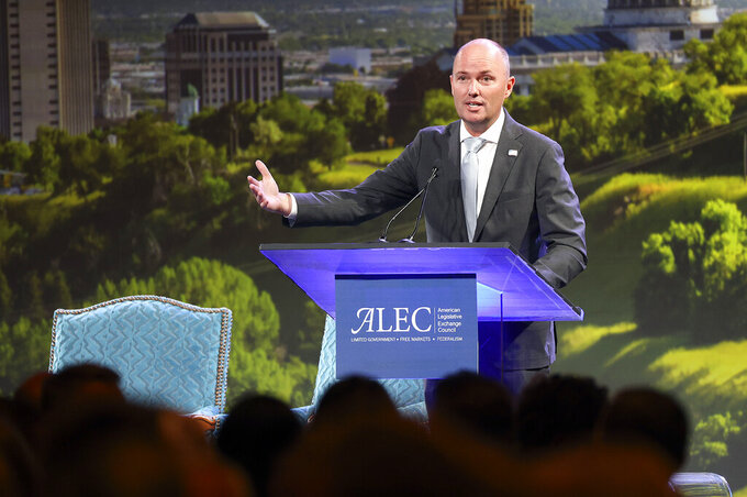 Utah Gov. Spencer Cox speaks during the American Legislative Exchange Council (ALEC) conference as the crowd talks over him and eats lunch at the Grand America Hotel in Salt Lake City on Thursday, July 29, 2021. (Kristin Murphy/The Deseret News via AP)