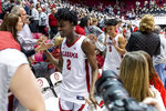 Alabama guard Kira Lewis Jr. (2) celebrates with fans after an upset win over LSU in an NCAA college basketball game, Saturday, Feb. 15, 2020, in Tuscaloosa, Ala. (AP Photo/Vasha Hunt)