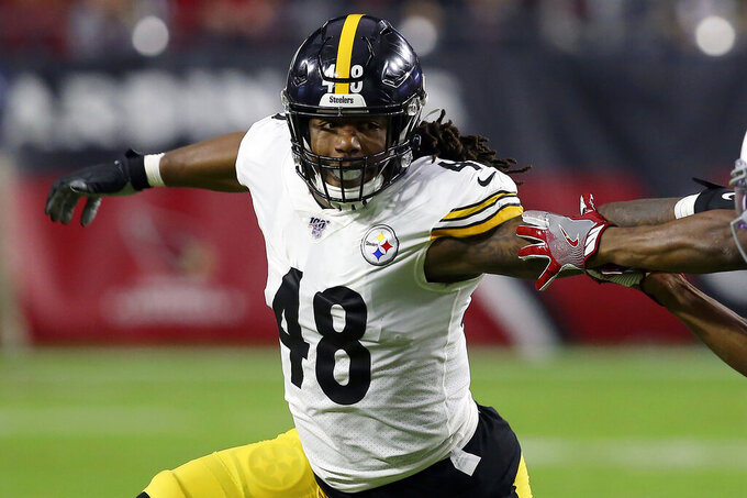 FILE - In this Dec. 8, 2019, file photo, Pittsburgh Steelers outside linebacker Bud Dupree (48) runs a play against the Arizona Cardinals prior to an NFL football game in Glendale, Ariz. The Pittsburgh Steelers are holding onto outside linebacker Bud Dupree. The team placed the franchise tag on Dupree Monday, March 16, 2020, just hours before the NFL-mandated deadline for teams to use the designation.(AP Photo/Ross D. Franklin, File)
