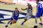Seton Hall guard Takal Molson (15) drives against Creighton guard Shereef Mitchell (4) during the first half of an NCAA college basketball game Wednesday, Jan. 6, 2021, in Omaha, Neb. (AP Photo/John Peterson)