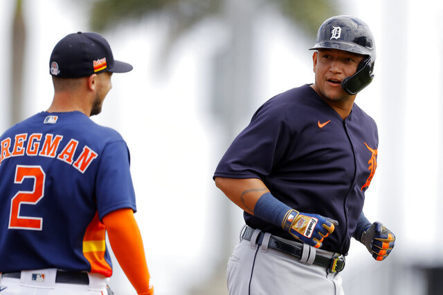 Detroit Tigers designated hitter Miguel Cabrera, right, talks with Houston Astros third baseman Alex Bregman during the first inning of a spring training baseball game, Monday, March 9, 2020, in West Palm Beach, Fla. (AP Photo/Julio Cortez)