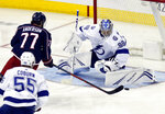 Tampa Bay Lightning goalie Andrei Vasilevskiy, right, of Russia, stops a shot by Columbus Blue Jackets forward Josh Anderson, center, as Lightning defenseman Braydon Coburn defends during the third period of an NHL hockey game in Columbus, Ohio, Monday, Feb. 18, 2019. Tampa Bay won 5-1. (AP Photo/Paul Vernon)