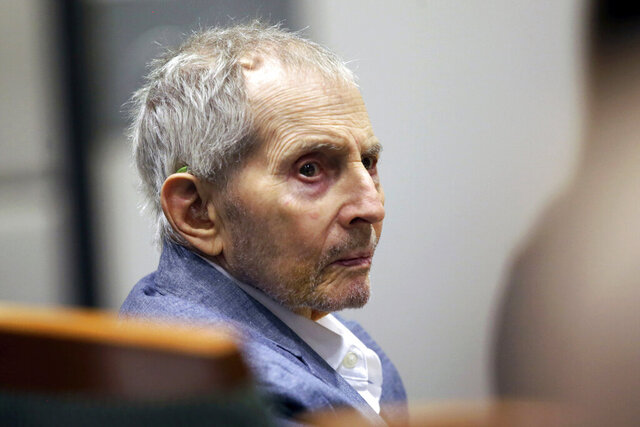 FILE - In this March 10, 2020, file photo, real estate heir Robert Durst looks over during his murder trial in Los Angeles. The California murder trial of real estate heir Durst is likely to move to a new venue this summer, depending on how a judge rules on a defense motion for a mistrial. The case against the 77-year-old scion of one of New York's wealthiest real estate dynasties is expected to move to the Inglewood courthouse from Los Angeles, The Daily Breeze reported Friday, May 22. (AP Photo/Alex Gallardo, Pool, File)